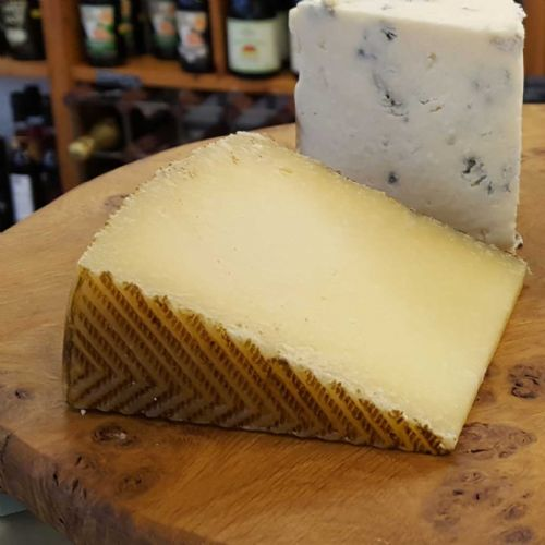 Manchego Cheese, traditional Spanish Ewe's milk cheese